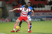 Donervan Daniels challenges John Marquis during the EFL Sky Bet League 1 match between Doncaster Rovers and Rochdale at the Keepmoat Stadium, Doncaster, England on 29 December 2017. Photo by Daniel Youngs.