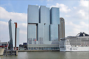 Nederland, Netherlands, Rotterdam, 2-5-2015Kop van Zuid, wilhelminakade, met de cruise terminal, cruiseschip de Splendida van MSC, en hoogbouw. De Rotterdam van architect Rem Koolhaas. District Kop van Zuid with cruise terminal and high-rise buildings. Building De Rotterdam from architect Rem Koolhaas.Cruiseship Splendida.FOTO: FLIP FRANSSEN/ HOLLANDSE HOOGTE