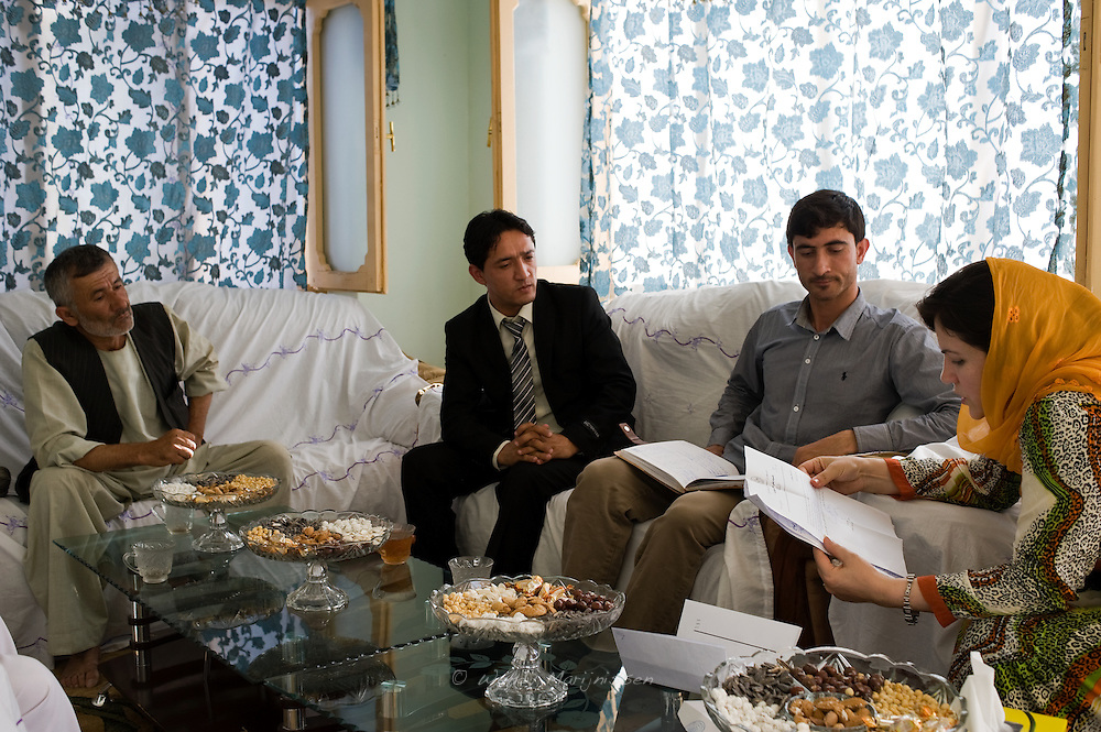 MP Ms. Fawzia Koofi attends one meeting after another, reads documents, gives advice and tries to assist people with problems while visiting her home province Badakshan. Faizabad, Afghanistan, 2012