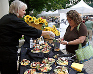 Folks gets samples from Atrium Grille & Deli during the 21st annual The Taste in the Lincoln Park Commons area at the Fraze Pavilion, Thursday, September 3, 2009.