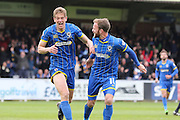 Paul Robinson defender for AFC Wimbledon (6) and Sean Rigg forward for AFC Wimbledon (11) in action during the Sky Bet League 2 match between AFC Wimbledon and Crawley Town at the Cherry Red Records Stadium, Kingston, England on 16 April 2016. Photo by Stuart Butcher.