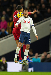 LONDON, ENGLAND - Saturday, January 11, 2020: Liverpool's Virgil van Dijk (L) challenges for a header with Tottenham Hotspur's Lucas Moura during the FA Premier League match between Tottenham Hotspur FC and Liverpool FC at the Tottenham Hotspur Stadium. (Pic by David Rawcliffe/Propaganda)