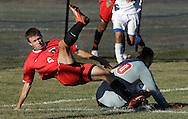 Shane McCooey of Port Jervis falls over Goshen goalie Brandon Miller during a game in Goshen on Thursday, Sept. 19, 2013.