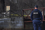 WASHINGTON (Jan 4, 2017) -- A D.C. Metro Police K9 handler stands near the location where a suspiciously stashed violin case was found containing two firearms, near Fletcher's Cove Boathouse on the C&O Canal late Wednesday morning Jan. 4, 2017.  More guns and ammunition were also found around the area.  Photo by Johnny Bivera