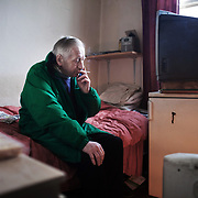 Mik in his bedsit in Hackney. Mik lives alone and the bed sit room is his only private space. Mik suffers from tuberculosis and is in treatment at the Homerton University Hospital in Hackney, East London.