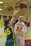 Marion's Alyssa Jones (32) puts up a shot over Beckman's Jenna Lansing (45) during their game at Marion High School, 675 South 15th Street, in Marion, on Tuesday evening, November 22, 2011. (Stephen Mally/Freelance)