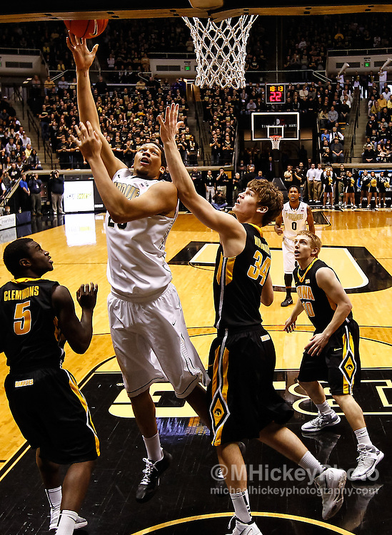 WEST LAFAYETTE, IN - JANUARY 27: A.J. Hammons #20 of the Purdue Boilermakers shoots the ball against Adam Woodbury #34 of the Iowa Hawkeyes at Mackey Arena on January 27, 2013 in West Lafayette, Indiana. (Photo by Michael Hickey/Getty Images) *** Local Caption *** A.J. Hammons; Adam Woodbury