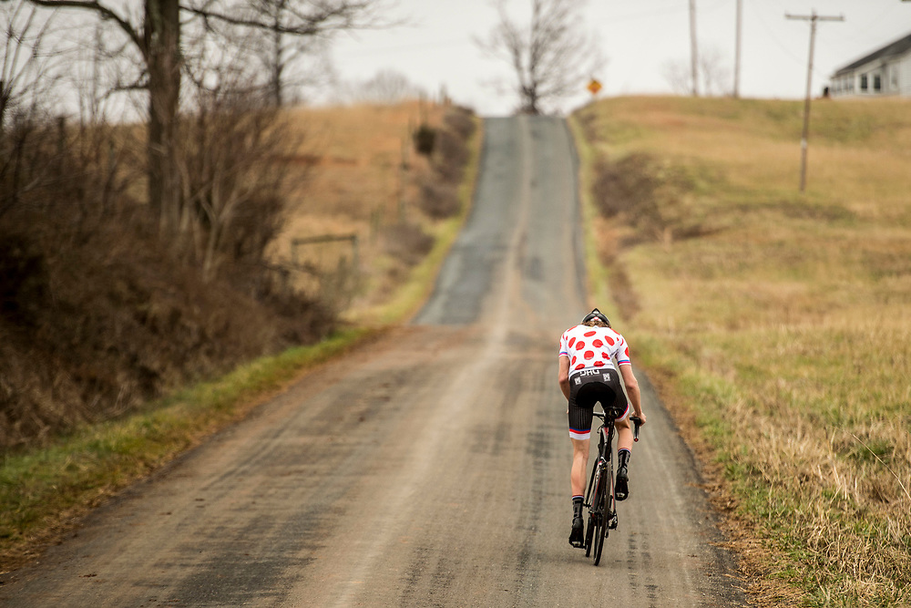"ELON, VA - JAN 21: Ben, wearing a ""King of the Mountains"" jersey he earned at Jeremiah Bishop's Gran Fondo, makes his way up a climb in Amherst County during a training ride on Saturday, Jan. 21, 2017 in Lynchburg, Va. (Photo by Jay Westcott/The News & Advance)"
