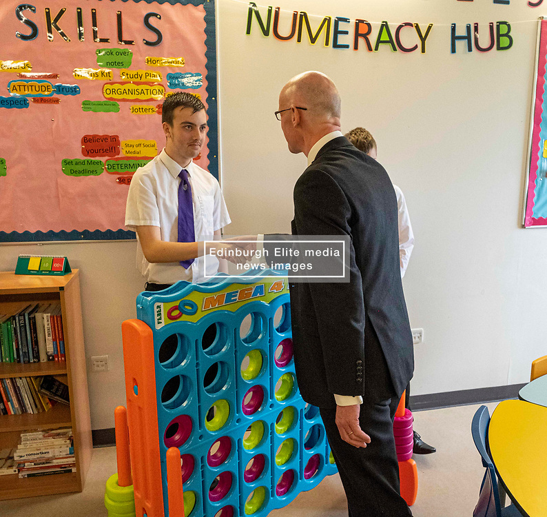 Pictured: John Swinney took up[ the challenge of connect four thrown down by Kieran McKenzie (S5).  Mr Swinney was glad he won.<br />
