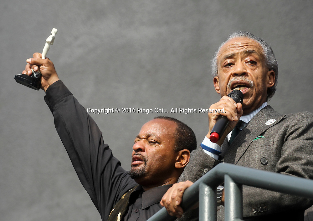 Najee Ali, left,  holds a white Oscar statue as Rev. Al Sharpton speaks during a rally and march circle to protest the all-white slate of Oscar acting nominees and calling for more diversity in the entertainment industry, Sunday Feb. 28, 2016 in Los Angeles.(Photo by Ringo Chiu/PHOTOFORMULA.com)<br /> <br /> Usage Notes: This content is intended for editorial use only. For other uses, additional clearances may be required.