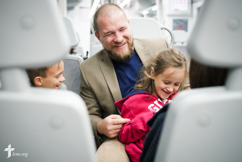 Noah and Abigail play with their father, the Rev. Adam Lehman, LCMS career missionary to Spain, on a short train ride Sunday, Nov. 6, 2016, in Seville, Spain.  LCMS Communications/Erik M. Lunsford