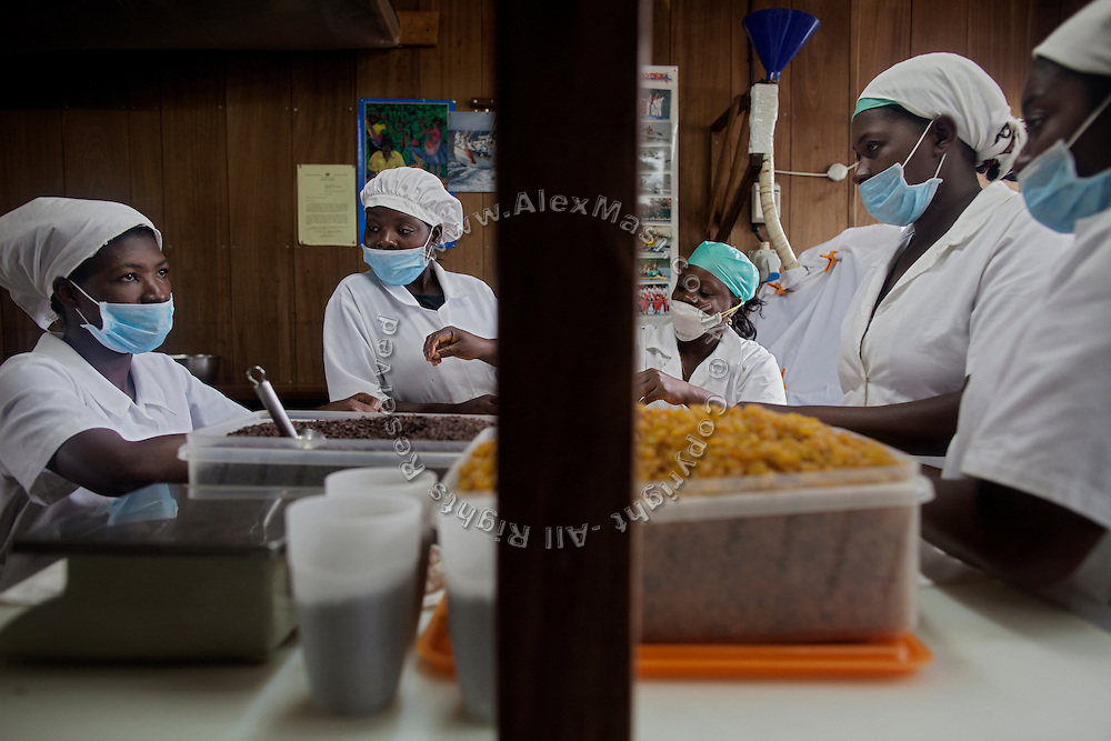 Workers are selecting raisins that Claudio Corallo uses for his varieties of chocolates with alcoholic distillates, while in his laboratory on the island of Sao Tome, Sao Tome and Principe, (STP) a former Portuguese colony in the Gulf of Guinea, West Africa.