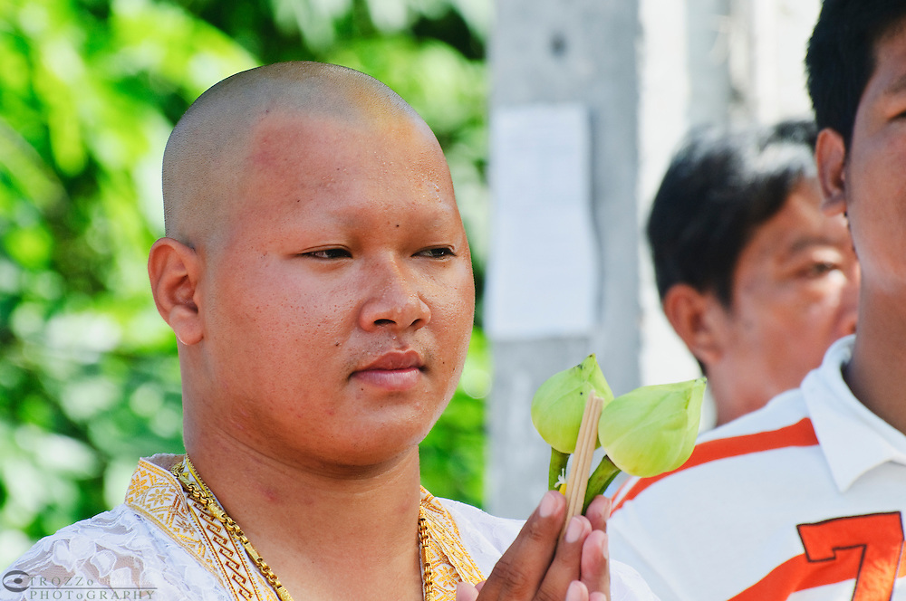 Buddhist novice ordination ceremony for new monk, Watt Prok a Buddhist Temple at Ta Luang Thailand near Damnoen Saduak
