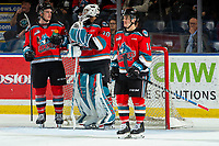 KELOWNA, BC - NOVEMBER 20:  Jake Lee #21 and Kyle Crosbie #18 stand at the net with Roman Basran #30 of the Kelowna Rockets while a play is under review on a goal scored by Sean Gulka #17 of the Victoria Royals at Prospera Place on November 20, 2019 in Kelowna, Canada. (Photo by Marissa Baecker/Shoot the Breeze)