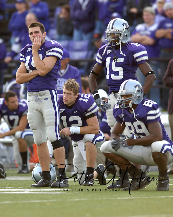 Kansas State players (L-R) Jeff Snodgrass, Allan Evridge, Davin Dennis and Rashaad Norwood have a look of concern, as teammate Jermaine Moreira is attended to by the medical staff at KSU Stadium in Manhattan, Kansas, October 29, 2005.  The Buffaloes beat K-State 23-20.