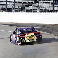 Matt DiBenedetto (32) races through turn three to practice  for the First Data 500 at Martinsville Speedway in Martinsville, Virginia.