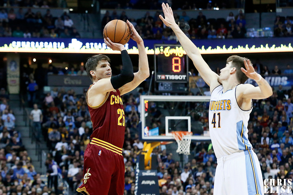 22 March 2017: Cleveland Cavaliers guard Kyle Korver (26) takes a jump shot over Denver Nuggets forward Juan Hernangomez (41) during the Denver Nuggets 126-113 victory over the Cleveland Cavaliers, at the Pepsi Center, Denver, Colorado, USA.