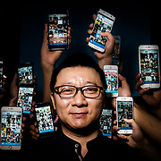 Beijing. Geng Le founder of Blued, the world's top gay dating app surrounded by his app.