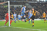 Hull City defender Ryan Taylor (5) kicks ball towards goal defelected by Brighton winger, Elvis Manu (19) during the The FA Cup match between Hull City and Brighton and Hove Albion at the KC Stadium, Kingston upon Hull, England on 9 January 2016. Photo by Ian Lyall.