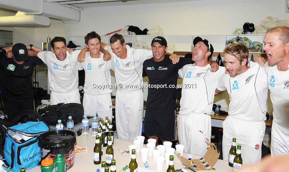 New Zealand players celebrate a famous test victory over Australia in the dressing room on Day 4 of the second cricket test between Australia and New Zealand Black Caps at Bellerive Oval in Hobart, Monday 12 December 2011. Photo: Andrew Cornaga/Photosport.co.nz