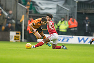 Liam Bridcutt of Nottingham Forest commits a fouls on Ruben Neves of Wolverhampton Wanderers during the EFL Sky Bet Championship match between Wolverhampton Wanderers and Nottingham Forest at Molineux, Wolverhampton, England on 20 January 2018. Photo by Darren Musgrove.