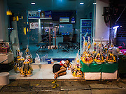 29 FEBRUARY 2016 - BANGKOK, THAILAND:  A sidewalk vendor in the Bangkok flower market sleeps early Monday. Many of the sidewalk vendors around Pak Khlong Talat, the Bangkok flower market, closed their stalls Monday. As a part of the military government sponsored initiative to clean up Bangkok, city officials announced new rules for the sidewalk vendors that shortened their hours and changed the regulations they worked under. Some vendors said the new rules were confusing and too limiting and most vendors chose to close Monday rather than risk fines and penalties. Many hope to reopen when the situation is clarified.   PHOTO BY JACK KURTZ