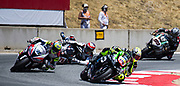 Jun 23  2018  Monterey, CA, U.S.A    # 99  PJ Jacobsen,# 36 Leandro Mercaddo battle for position as # 76 Lois Baz falls in turn 11 during the Motul FIM World Superbike Race # 1 at Weathertech Raceway Laguna Seca  Monterey, CA  Thurman James / CSM