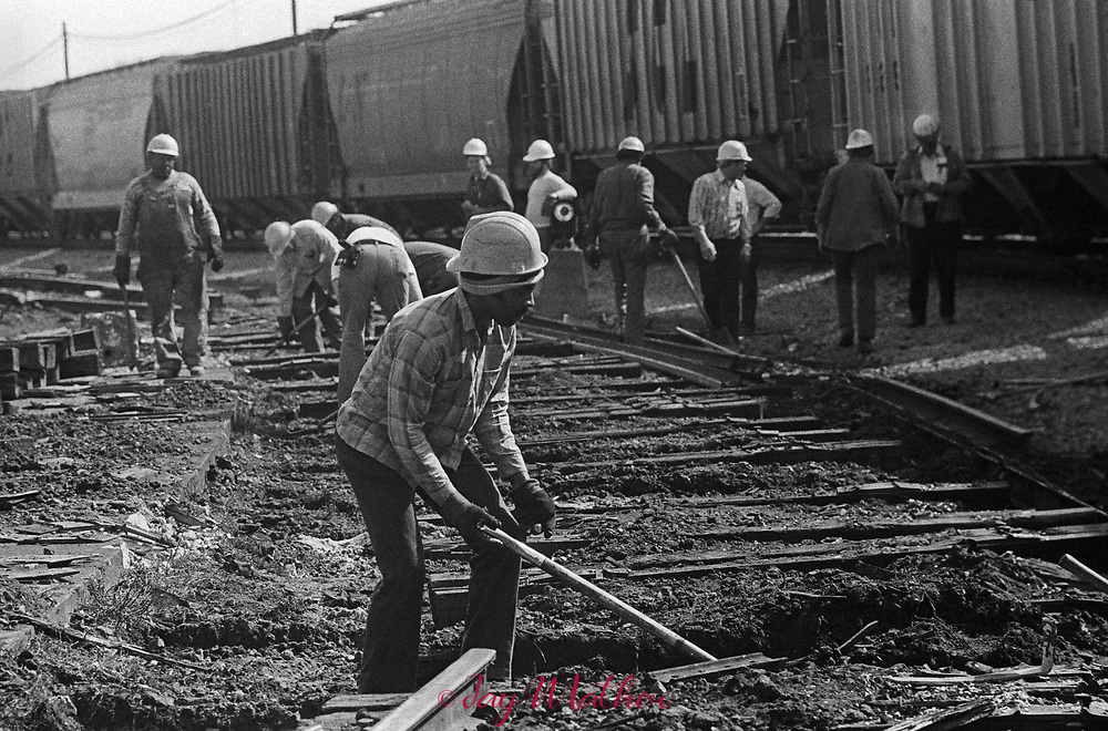 The Amtrak Floridian passenger train that operated between Chicago, Illinois and Miami, Florida ceased operation in 1979.  It was the last passenger train that serviced Louisville. Kentucky as well.  These photographs document the final days for the workers in the Chicago Yards, the Amtrak employees aboard the train, an engineer,, W.C. Roddy, that drove the train between Louisville and Bowling Green, KY and the passengers who enjoyed riding the rails.<br /> <br /> Pictured:  Track repair in central Kentucky delays the Floridian passenger train.  Once the freight train passed, the Floridian continued on but two hours behind schedule.