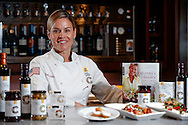 Photograph of Celebrity Chef Cat Cora in the kitchen at Rouses Markets in New Orleans, LA.