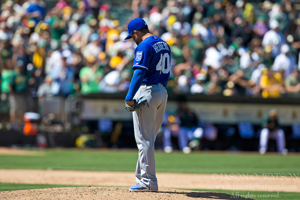 OAKLAND, CA - MAY 19:  Kelvin Herrera #40 of the Kansas City Royals reacts after giving up a home run to Yoenis Cespedes (not pictured) of the Oakland Athletics during the eighth inning at O.co Coliseum on May 19, 2013 in Oakland, California. The Oakland Athletics defeated the Kansas City Royals 4-3.  (Photo by Jason O. Watson/Getty Images) *** Local Caption *** Kelvin Herrera