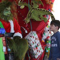 Libby Ezell | BUY AT PHOTOS.DJOURNAL.COM<br /> Cameron Stafford, 9, of Guntown talks to the Grinch about why he likes to takes presents from the Who of Whoville Saturday at the Oren Dunn City Museum
