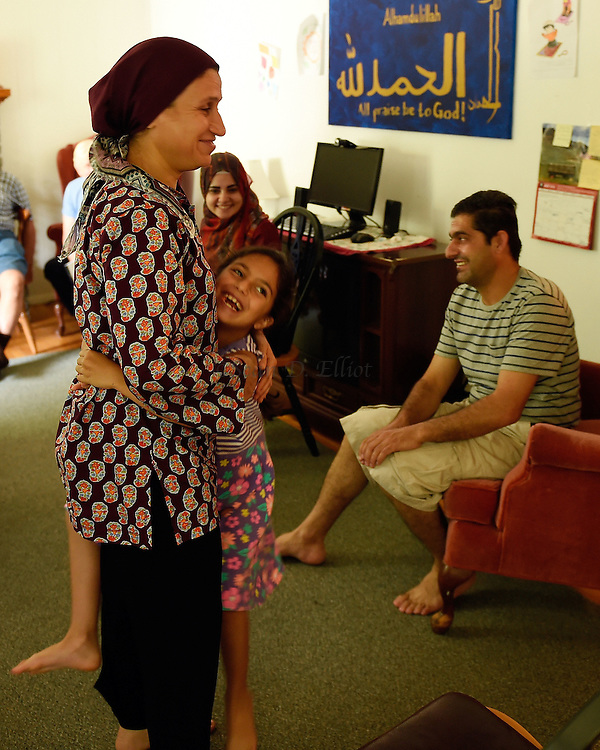 1005612433 :: 7/22/16 :: REGION :: LYNCH :: Hassan Mahmud and his wife Fahima Jmoo and their children Hanif, Fidan and Fulla  are refugees from the conflict in Syria and lived for three years in Turkey before finally receiving approval to come to the United States. Ledyard Congregational Church is hosting the family and providing support. (Sean D. Elliot/The Day)