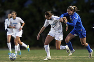 30 November 2013: North Carolina's Summer Green (6) fights through a foul by UCLA's Jenna Richmond (right). The University of North Carolina Tar Heels played the University of California Los Angeles Bruins at Fetzer Field in Chapel Hill, North Carolina in a 2013 NCAA Division I Women's Soccer Tournament Quarterfinal match. UCLA won the game 1-0 in two overtimes.