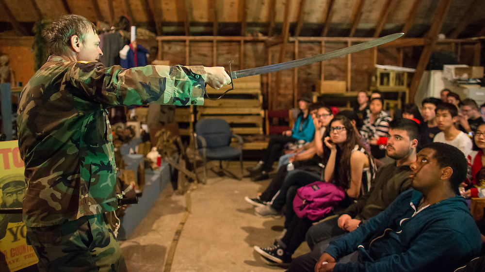 Tillsonburg, Ontario ---2014-05-30--- Students from Central Commerce Collegiate high school in Toronto listen as Robin Barker-James talks about World War 1 weapons during a field trip to the  Bill Findley Outdoor Education Centre in Tillsonburg, Ontario, May 30, 2014 where the students learned what it was like to be a soldier in the trenches in World War 1.<br /> GEOFF ROBINS Toronto Star