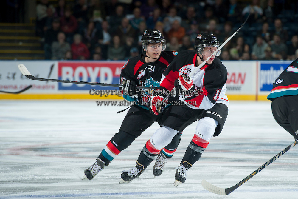 KELOWNA, CANADA - OCTOBER 19: Nick Merkley #10 of the Kelowna Rockets checks a player of the Prince George Cougars on October 19, 2013 at Prospera Place in Kelowna, British Columbia, Canada.   (Photo by Marissa Baecker/Shoot the Breeze)  ***  Local Caption  ***