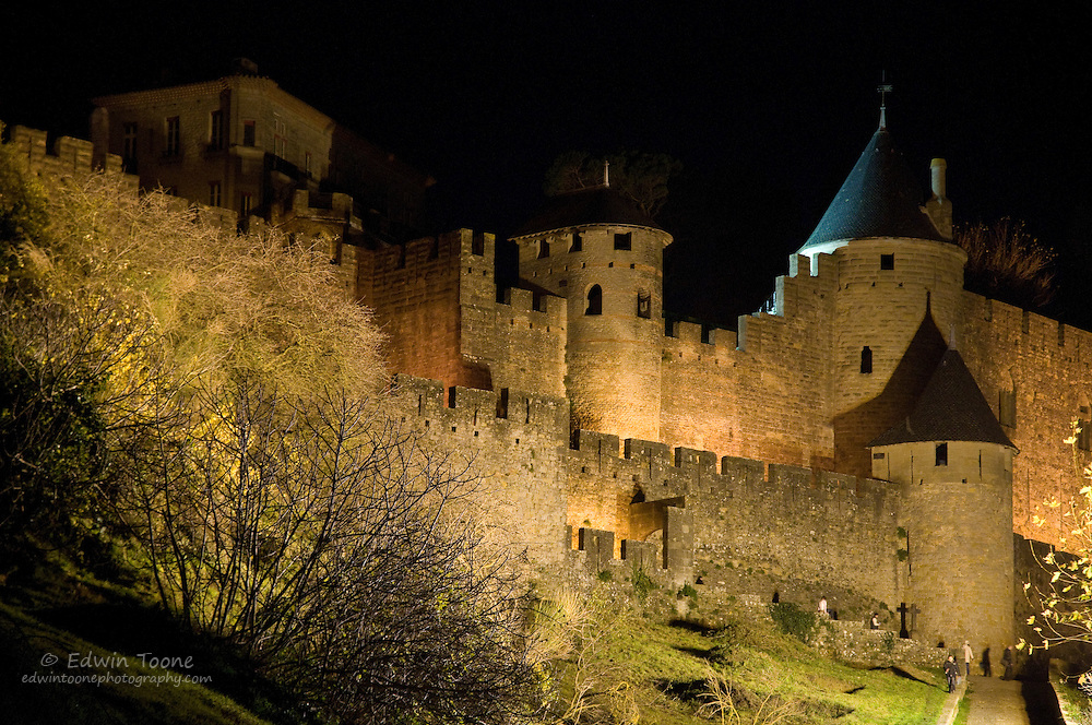 The castle in Carcassonne, France lit up at night.