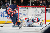 KELOWNA, CANADA - JANUARY 27: Michael Herringer #30 of the Kelowna Rockets makes a save on a second period shot by Lane Bauer #25 of the Kamloops Blazers on January 27, 2017 at Prospera Place in Kelowna, British Columbia, Canada.  (Photo by Marissa Baecker/Shoot the Breeze)  *** Local Caption ***