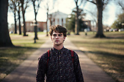 "OXFORD, MS – FEBRUARY 3, 2017: Allen Coons, 21, walks between classes on the University of Mississippi campus. In 2015, as a student senator, Coons authored a bill that led to the removal of the Mississippi flag from the state's flagship campus. He and other liberals argued that the flag has no place so long as the Confederate flag remains embedded in the design. The backlash was furious, and on campus, white conservative students formed a pro-flag bloc and swept the senate elections. Despite the backlash, Coons has remained unrepentant, even defiant. In November, he drew attention once again by floating proposed legislation that would have made Ole Miss a ""sanctuary campus."" He intends on reintroducing the legislation before the year's end. ""You can just tell racist ideologies dominate this environment,"" Coons said. ""One week I was a normal college student, but simply because I was involved in pro-black movement the next week I couldn't go into certain bars. I get harassed."" On one occasion, Coons said, he was pushed by a man who later threatened the life of his black girlfriend. ""I think if we were much more honest about our racial history, students of color would feel much more comfortable being here because we'd by trying to have those hard conversations,"" Coons said. ""But we don't. I just worry about humanity a lot."" <br /> CREDIT: Bob Miller for The New York Times"