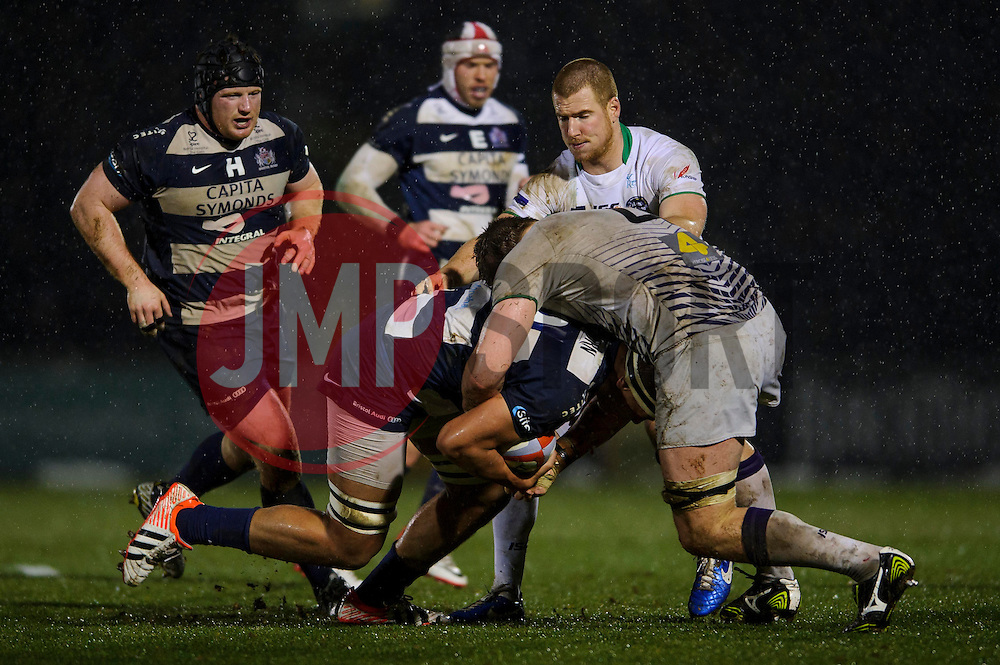 Bristol replacement (#19) Ben Glynn is tackled by Leeds Carnegie Lock (#4) Calum Green during the second half of the match - Photo mandatory by-line: Rogan Thomson/JMP - Tel: Mobile: 07966 386802 25/01/2013 - SPORT - RUGBY - Memorial Stadium - Bristol. Bristol v Leeds Carnegie - RFU Championship.