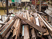 14 NOVEMBER 2017 - BANGKOK, THAILAND:  Lumber recovered from a demolished home south of the Krung Thon Bridge. The home was demolished to make way for the city's plan to build a 14 kilometer long (22 mile) riverfront promenade. The city also maintains that the homes interfere with navigation on the river and pose a health a safety hazard because they are prone to seasonal flooding. Thousands of families are expected to be evicted to accommodate the promenade. The riverside communities, built on stilts over the water, are prone to flooding and the city has been trying to control them for years. The houses are the only affordable housing for available to some of the poorest people in Bangkok.  PHOTO BY JACK KURTZ