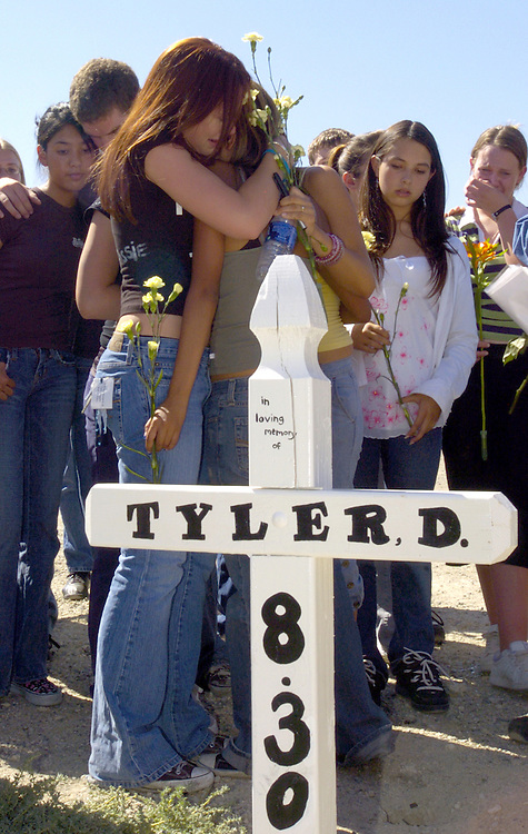 Students gather for a memorial at 30th Street West and Avenue J for Tyler Duggins, a Lancaster High School student, who died in a car accident Tuesday morning August 30th.  KELLY LACEFIELD/ Valley Press Sep 2, 2005