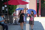 8月29日,在美国加利福尼亚州洛杉矶,民众顶着雨伞遮挡阳光。当日,由于南加州迎来一股热浪,洛杉矶地区的气温高于正常水平18度,许多地区气温将直逼100℉以上。破纪录高的气温将持续至周末,加州能源部敦促民众要自发节省用电。新华社发 (赵汉荣摄)<br /> Women hold umbrellas to shield themselves from the sun in Chinatown on Tuesday, August 29, 2017, in Los Angeles, the United States. Record-breaking heat will persist across Southern California Tuesday, with Los Angeles County temperatures up to 18 degrees above normal, and forecasters issued a heat advisory for the Los Angeles County coast. California energy authorities urged voluntary conservation of electricity Tuesday as a wave of triple-digit heat strained the state's power grid. (Xinhua/Zhao Hanrong)(Photo by Ringo Chiu)<br /> <br /> Usage Notes: This content is intended for editorial use only. For other uses, additional clearances may be required.