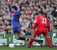Photo: Lee Earle.<br /> Liverpool v Manchester United. The FA Cup. 18/02/2006. United's Cristiano Ronaldo (L) is tripped by Jamie Carragher.