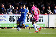 AFC Wimbledon striker Lyle Taylor (33) dribbling and taking on Southend United defender Anton Ferdinand (35) during the EFL Sky Bet League 1 match between AFC Wimbledon and Southend United at the Cherry Red Records Stadium, Kingston, England on 25 March 2017. Photo by Matthew Redman.