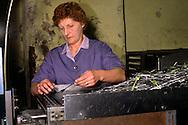 Women working with fork blanks in a cutlery factory in Sheffield ......