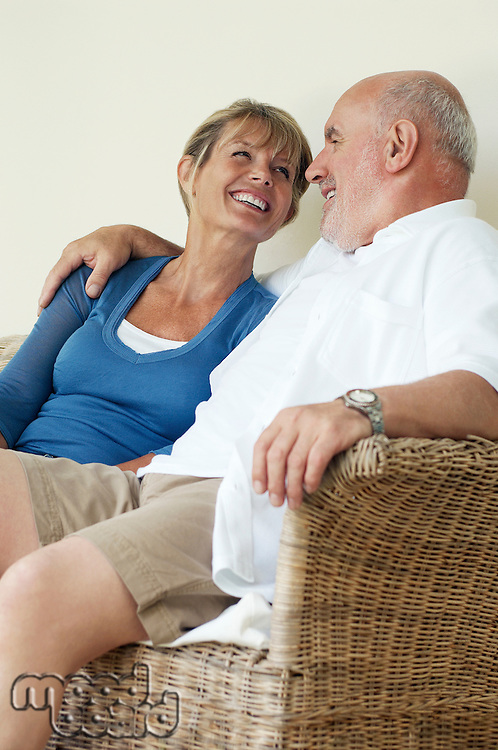 Middle Aged Couple sitting on wicker chair