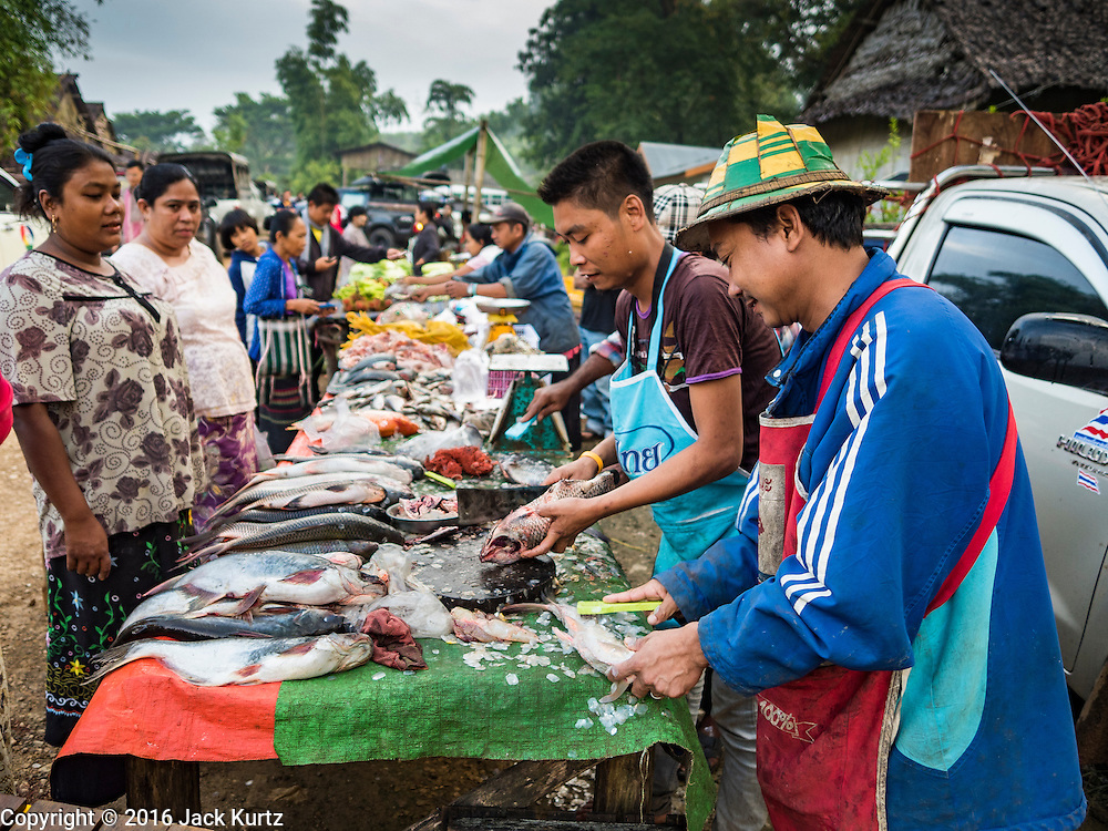 26 OCTOBER 2016 - NUPO TEMPORARY SHELTER, MAE CHAN, TAK, THAILAND:  Fish mongers sell fresh fish to Burmese refugees in the Nupo Temporary Shelter refugee camp. Sixtyfive Burmese refugees living in the Nupo Temporary Shelter refugee camp in Tak Province of Thailand were voluntarily repatriated to Myanmar. About 11,000 people live in the camp. The repatriation was the first large scale repatriation of Myanmar refugees living in Thailand. Government officials on both sides of the Thai / Myanmar border said the repatriation was made possible by recent democratic reforms in Myanmar. There are approximately 150,000 Burmese refugees living in camps along the Thai / Myanmar border. The Thai government has expressed interest several times in the last two years in starting the process of repatriating the refugees.    PHOTO BY JACK KURTZ