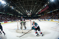 KELOWNA, CANADA - FEBRUARY 7:  Colum McGauley #23 of the Kelowna Rockets skates behind the net of David Tendeck #30 of the Vancouver Giants during first period on February 7, 2018 at Prospera Place in Kelowna, British Columbia, Canada.  (Photo by Marissa Baecker/Shoot the Breeze)  *** Local Caption ***