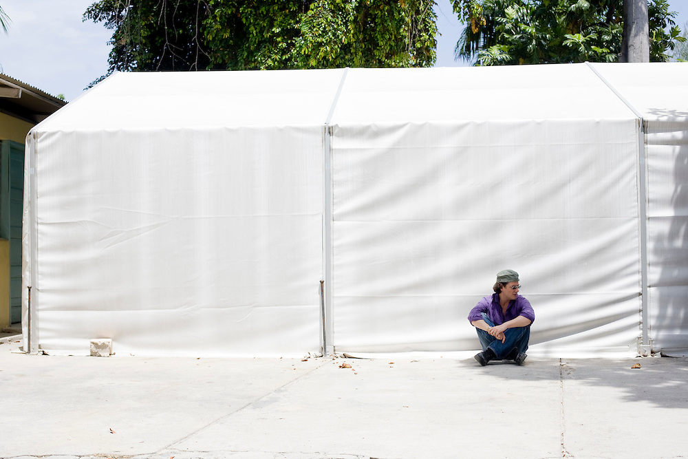 David Koubbi, sits in front of the tent that is now the Ministry of Justice. Koubbi waits to meet with officials at the Ministry of Justice to check the status of his case. Koubbi, a French lawyer, is visiting Haiti to advocate to the Haitian government for passports for 56 children. The children were in the adoption process before the earthquake and though the adoptions have all been finalized, the children need passports before they can join their adopted families in France.