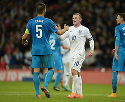 Wayne Rooney of England (Manchester United) embraces Bostjan Cesar of Slovenia  - Photo mandatory by-line: Alex James/JMP - Mobile: 07966 386802 - 15/11/2014 - SPORT - Football - London - Wembley - England v Slovenia - EURO 2016 Qualifier